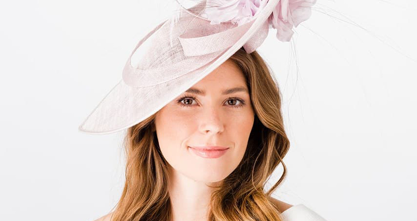 A model wearing a fascinator from Hats & Tiaras
