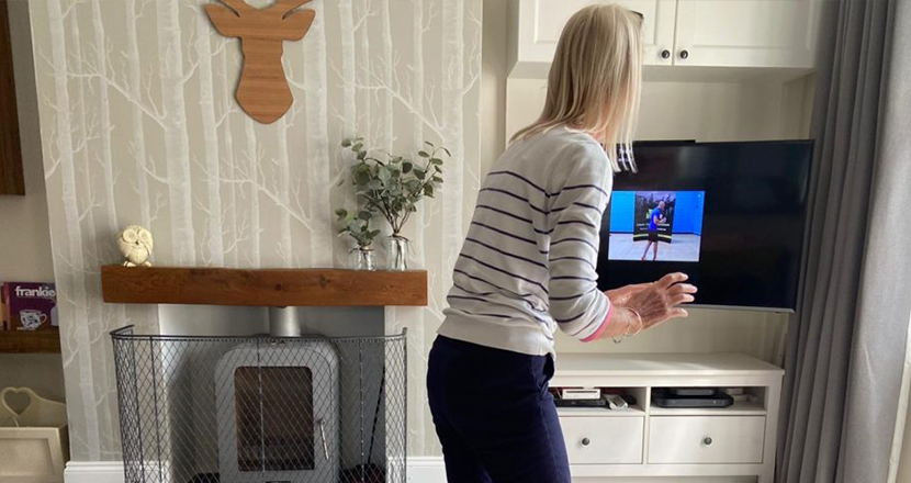 Older lady working out at home