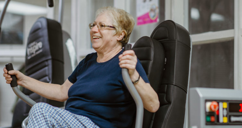 Older lady working out in a gym