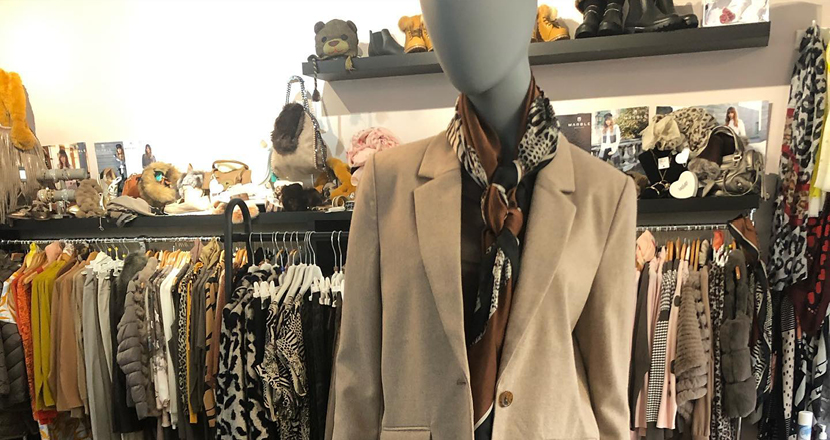 A mannequin wearing clothing from The Boutique