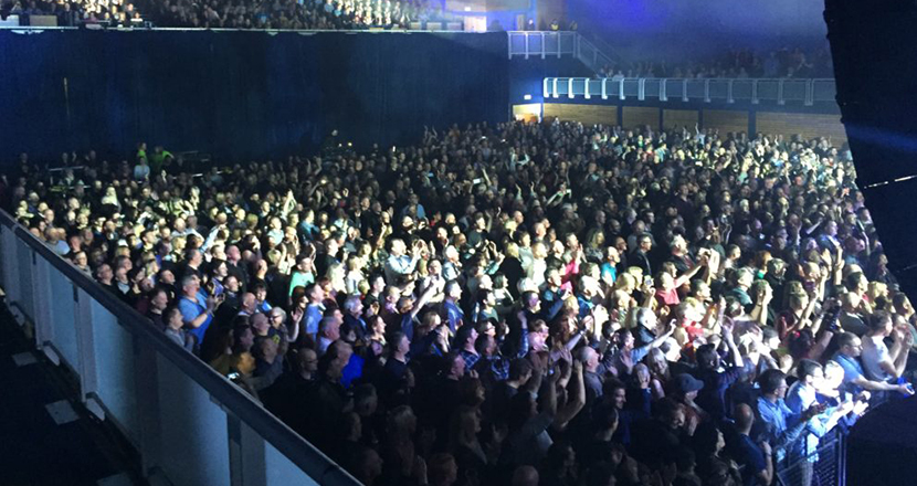 A photograph of a large crowd at Grimsby Auditorium