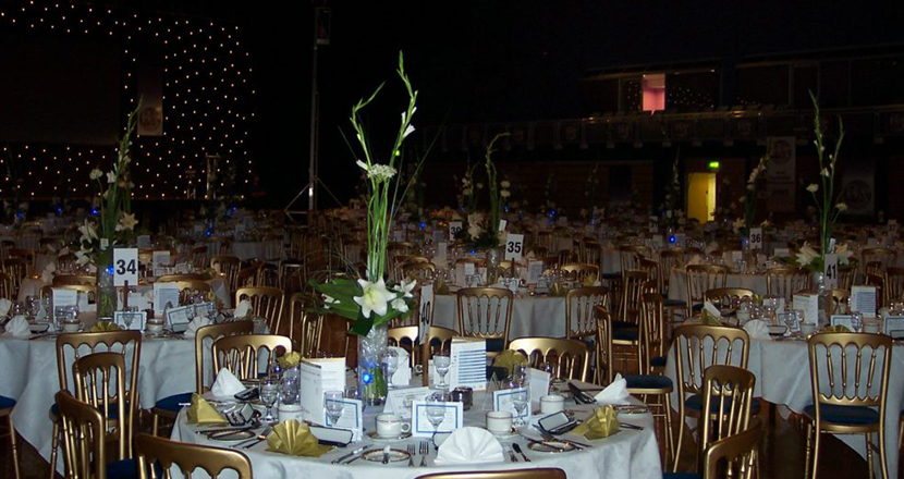 A photograph of dressed tables at Grimsby Auditorium