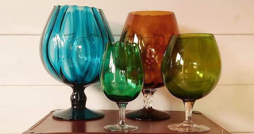 A photograph of colourful glassware