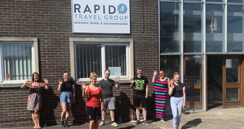 A photograph of Rapid Travel Group employees