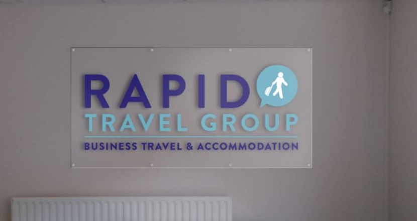 A photograph of Rapid Travel Group signage