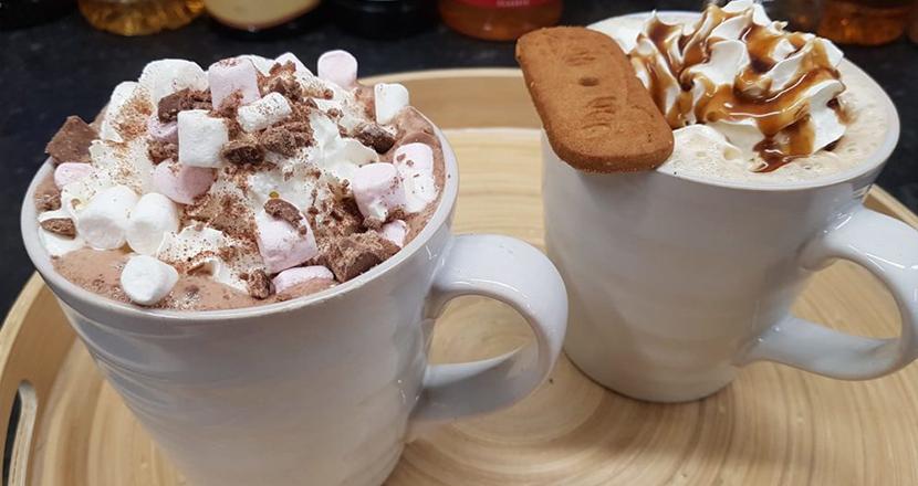 Image of two mugs of hot chocolate
