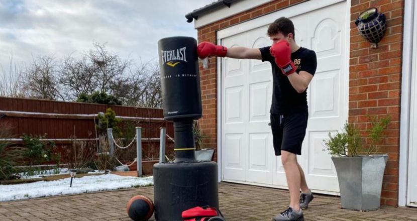 Man boxing outsite