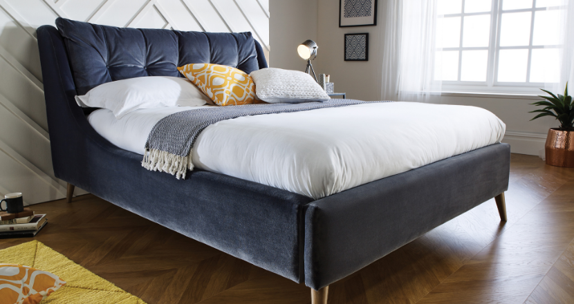 bed with cushions on